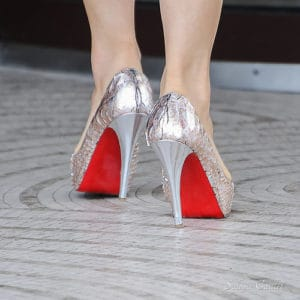 If you make women's shoes with red bottoms you will get sued!